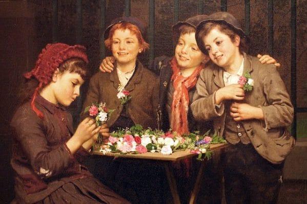Un groupe d'enfants autour d'une table jonchée de fleurs